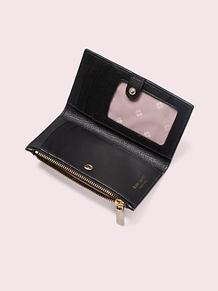 sylvia perforated small slim bifold wallet by kate spade new york hover view